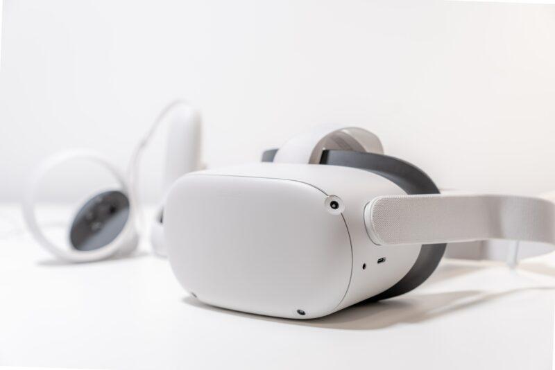 White Virtual Reality Oculus headset on white table