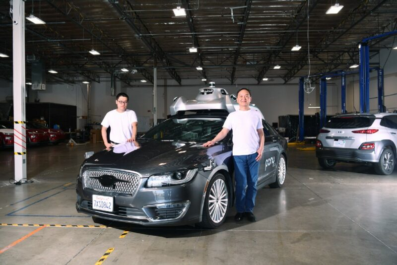 Founders James Peng and Lou Tiancheng with one of their Pony.ai vehicles at the California headquarters