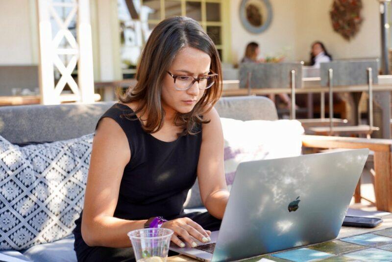 Fatima Husain sitting in front of laptop